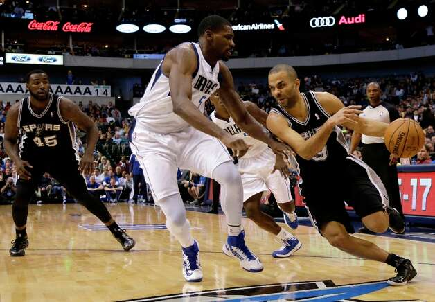 San Antonio Spurs' DeJuan Blair (45) watches as Tony Parker (9) of France attempts to get past Dallas Mavericks' Bernard James (5) in the second half of an NBA basketball game Friday, Jan. 25, 2013, in Dallas. The Spurs won 113-107. (AP Photo/Tony Gutierrez) Photo: Tony Gutierrez, Associated Press / AP