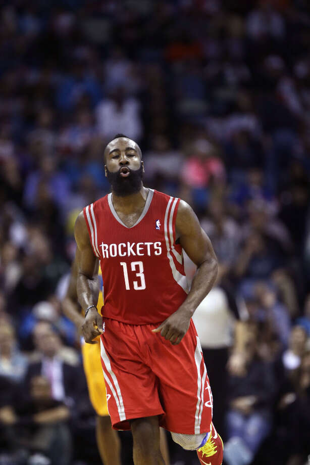 Rockets guard James Harden jogs down the court to play defense against the Hornets. Photo: Gerald Herbert