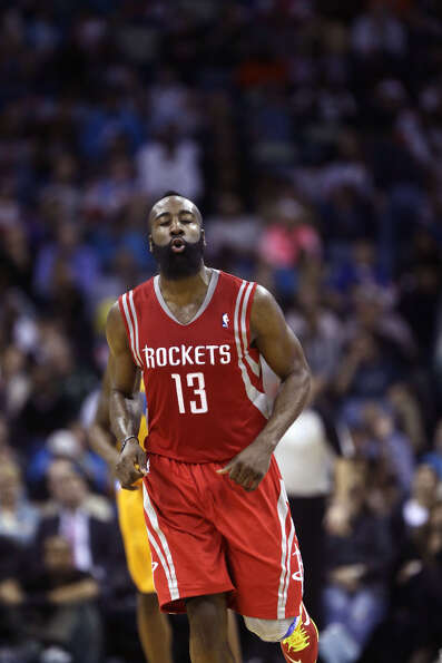Rockets guard James Harden jogs down the court to play defense against the Hornets.