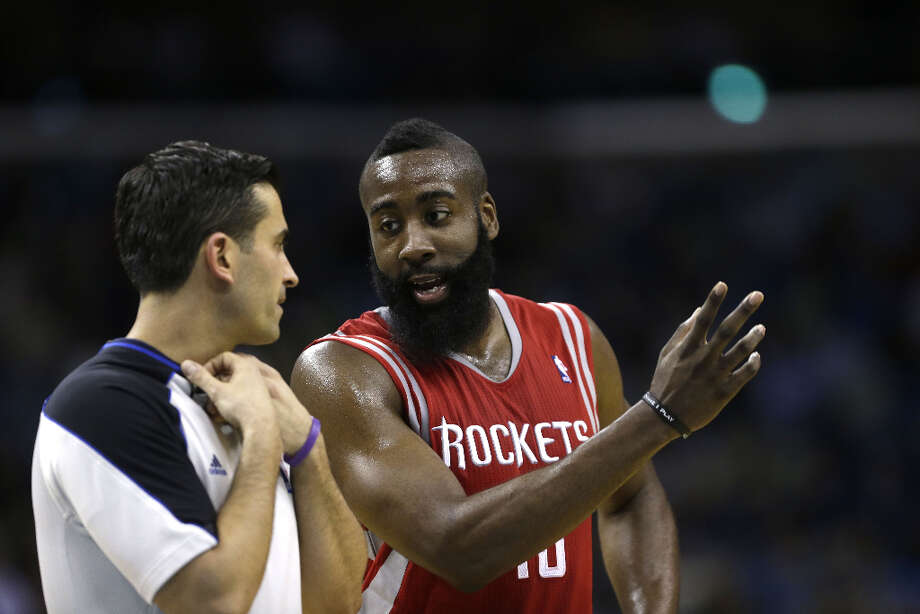 Rockets guard James Harden speaks with an official in the second half. Photo: Gerald Herbert