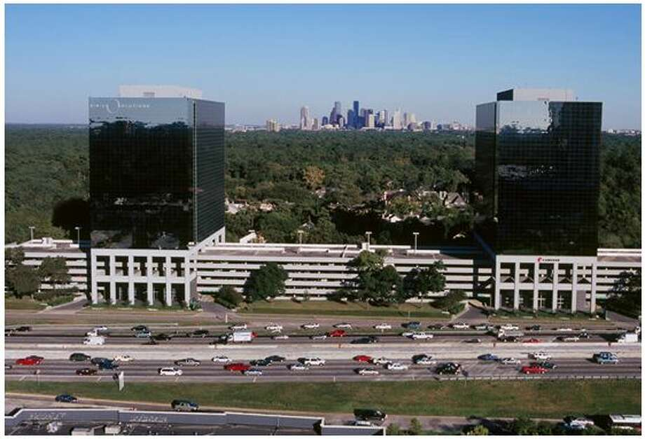 In May, Colliers International will move into a 22,250-square-foot space in the Park Towers North building at 1233 West Loop South, at left. Cameron is a tenant at the adjacent Park Towers South. Photo: Courtesy Photo
