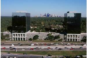 In May, Colliers International will move into a 22,250-square-foot space in the Park Towers North building at 1233 West Loop South, at left. Cameron is a tenant at the adjacent Park Towers South.