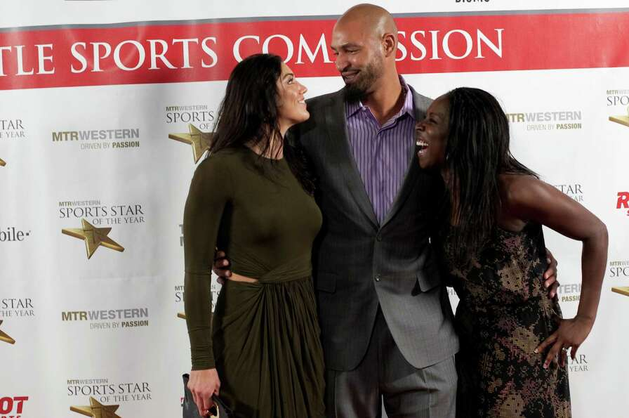 From left, soccer star Hope Solo, her husband, former NFL player Jerramy Stevens and soccer player T