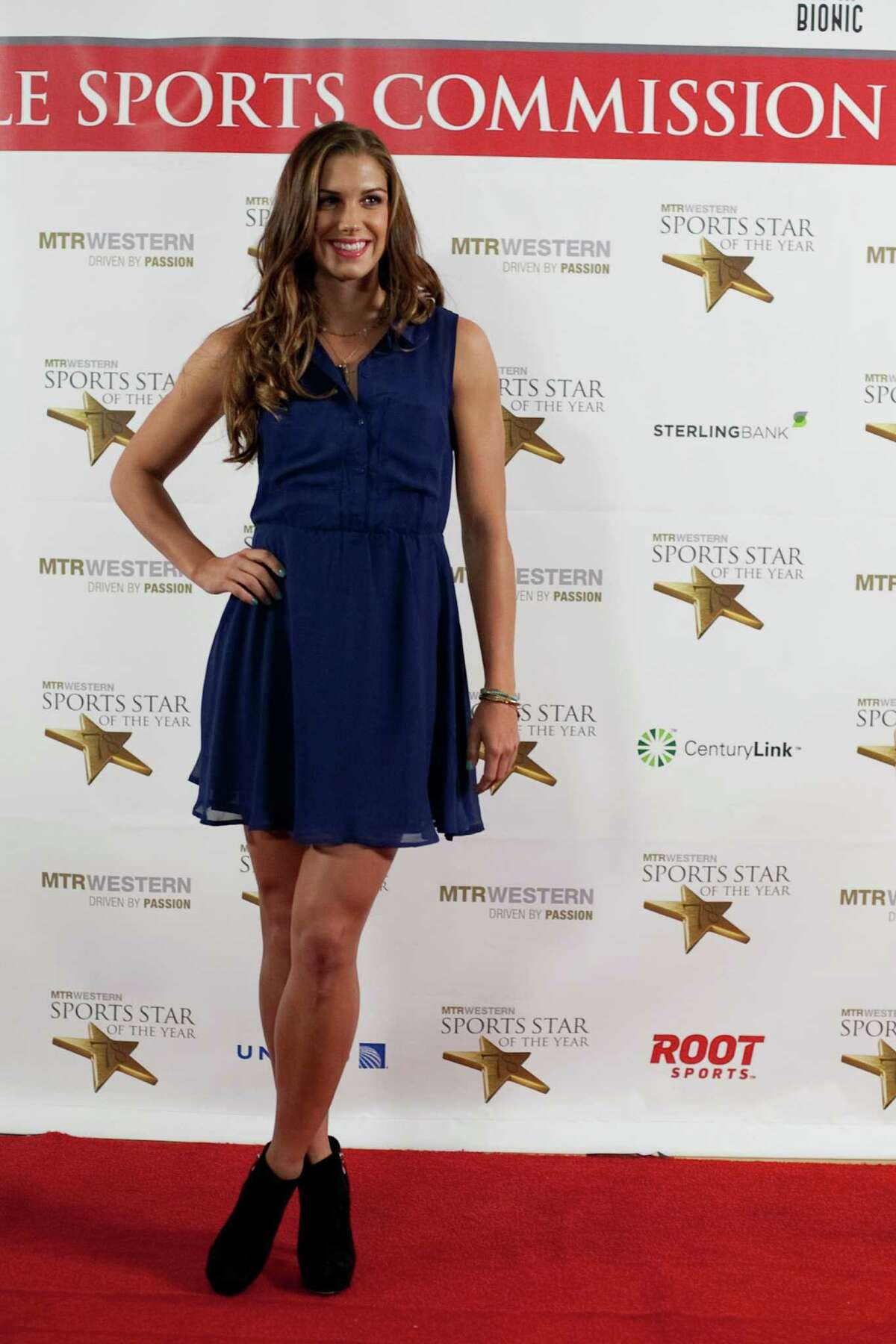 Soccer player Alex Morgan pauses on the red carpet during the 78th annual Sports Star of the Year awards at Benaroya Hall on Friday, January 25, 2013.