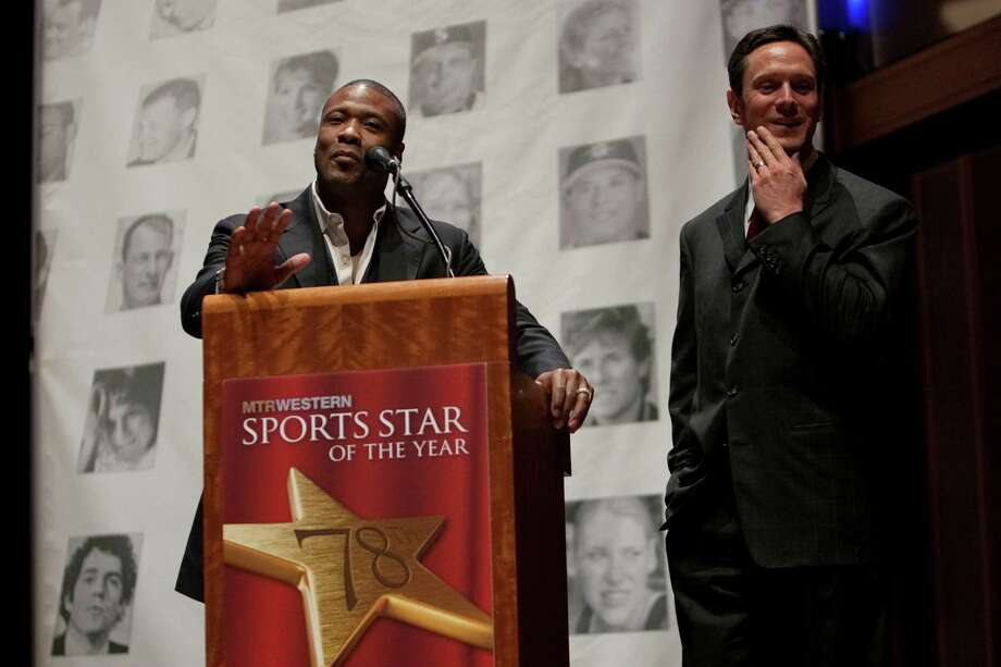 Former NFL football player Lawyer Milloy, a former Husky, teases former NFL player Drew Bledsoe, a former Coug, during the 78th annual Sports Star of the Year awards at Benaroya Hall on Friday, January 25, 2013. Photo: JOSHUA TRUJILLO, SEATTLEPI.COM / SEATTLEPI.COM