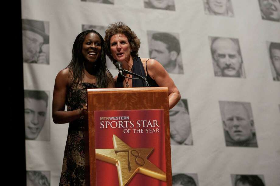 Soccer player Tina Ellertson and National Soccer Hall of Fame member Michelle Akers present the Female Sports Star of the Year award during the 78th annual Sports Star of the Year awards at Benaroya Hall on Friday, January 25, 2013. Photo: JOSHUA TRUJILLO, SEATTLEPI.COM / SEATTLEPI.COM