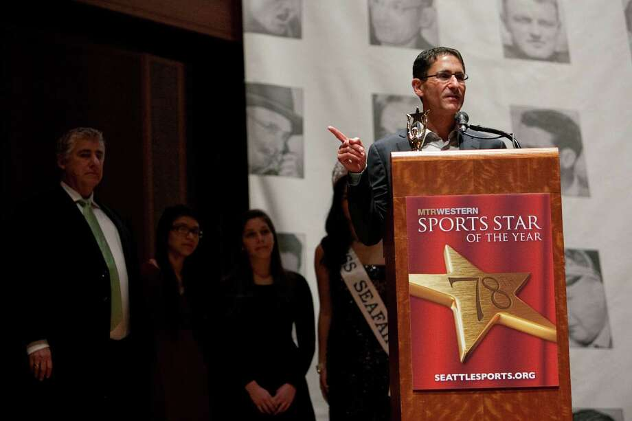 Seattle Sounders general manager and co-owner Adrian Hanauer accepts the Sports Executive of the Year award during the 78th annual Sports Star of the Year awards at Benaroya Hall on Friday, January 25, 2013. Photo: JOSHUA TRUJILLO, SEATTLEPI.COM / SEATTLEPI.COM