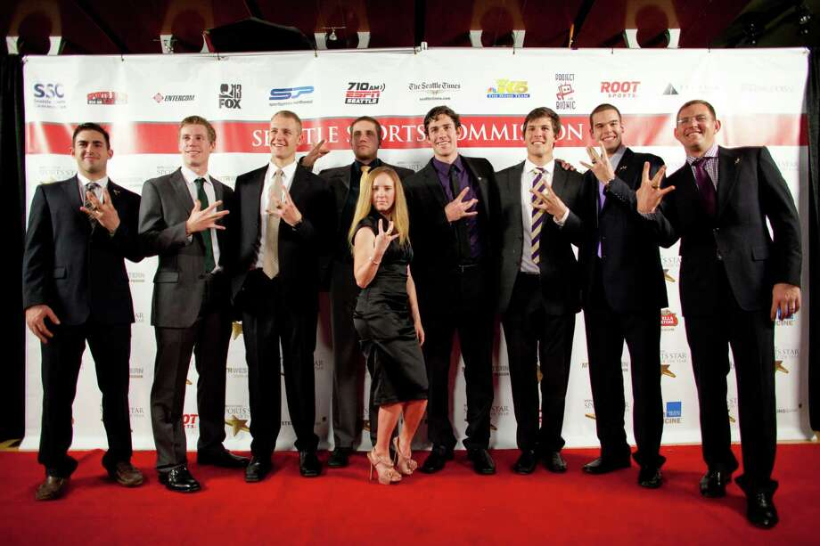 The UW Mens Rowing Team and coxwain Mary Whipple show their best 'W' on the red carpet during the 78th annual Sports Star of the Year awards at Benaroya Hall on Friday, January 25, 2013. Photo: JOSHUA TRUJILLO, SEATTLEPI.COM / SEATTLEPI.COM