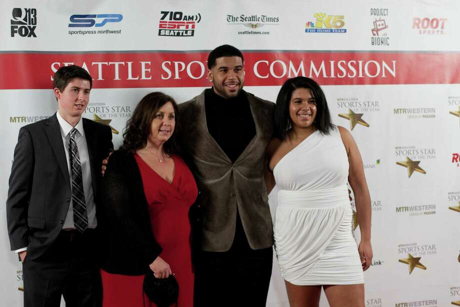 From left, Scott McGinty, Linda Seferian, UW football player Austin Seferian-Jenkins and Michaela Seferian-Jenkins pause on the red carpet during the 78th annual Sports Star of the Year awards at Benaroya Hall on Friday, January 25, 2013. Photo: JOSHUA TRUJILLO, SEATTLEPI.COM / SEATTLEPI.COM