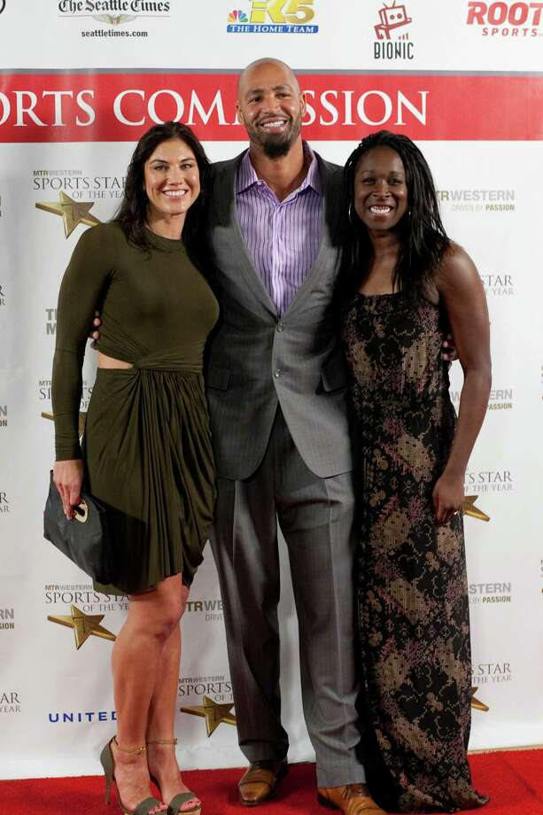 From left, soccer star Hope Solo, her husband, former NFL player Jerramy Stevens and soccer player Tina Ellertson stop on the red carpet during the 78th annual Sports Star of the Year awards at Benaroya Hall on Friday, January 25, 2013. Photo: JOSHUA TRUJILLO, SEATTLEPI.COM / SEATTLEPI.COM