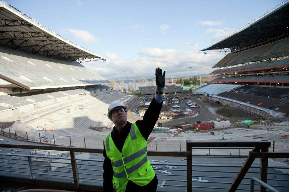 Associate Athletic Director Chip Lydum explains new features during a tour of the Husky Stadium construction site on Friday, January 25, 2013. The stadium is undergoing a rebuild and is planned to open in time from the 2013 football season. Photo: JOSHUA TRUJILLO, SEATTLEPI.COM / SEATTLEPI.COM