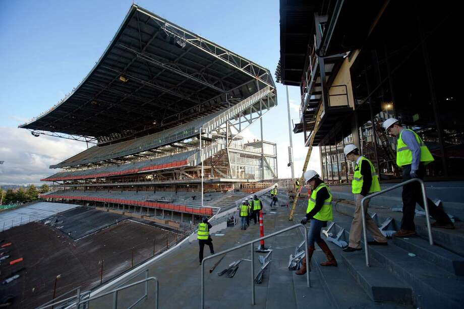 Visitors walk to the south grandstand during a tour of the Husky Stadium construction site on Friday, January 25, 2013. The stadium is undergoing a rebuild and is planned to open in time from the 2013 football season. Photo: JOSHUA TRUJILLO, SEATTLEPI.COM / SEATTLEPI.COM