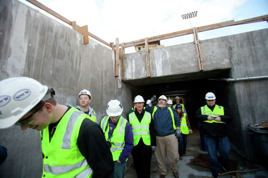 Visitors exit the tunnel during a tour of the Husky Stadium construction site on Friday, January 25, 2013. The stadium is undergoing a rebuild and is planned to open in time from the 2013 football season. Photo: JOSHUA TRUJILLO, SEATTLEPI.COM / SEATTLEPI.COM