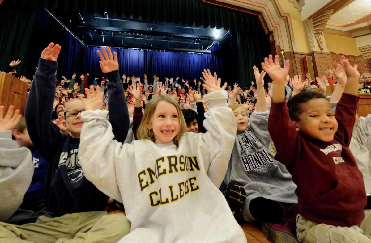 Anabelle Van Plew, center, may have lost her two front teeth but not her college sweatshirt as over 300 students, faculty and staff at the Doane Stuart School Jan. 25, 2013, gathered, in Rensselaer, N.Y., all donning college sweatshirts of their choice, to recognize the implications and significance, not only of choosing to attend college, but of choosing the ?right? college for each individual. (Skip Dickstein/Times Union)