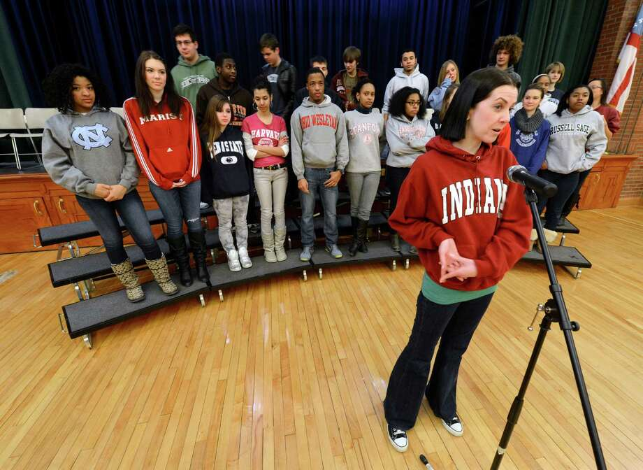 Kathleen Brack, Director of College Counseling, foreground, organized over 300 students, faculty and staff at the Doane Stuart School Jan. 25, 2013,  in Rensselaer, N.Y., as they donned college sweatshirts of their choice, to recognize the implications and significance, not only of choosing to attend college, but of choosing the ?right? college for each individual.   (Skip Dickstein/Times Union) Photo: SKIP DICKSTEIN / 00020862A