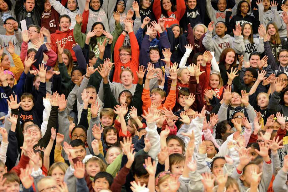 Over 300 students, faculty and staff at the Doane Stuart School Jan. 25, 2013, gathered, in Rensselaer, N.Y., all donning college sweatshirts of their choice, to recognize the implications and significance, not only of choosing to attend college, but of choosing the ?right? college for each individual.   (Skip Dickstein/Times Union) Photo: SKIP DICKSTEIN / 00020862A