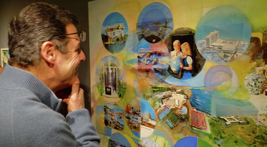 """Rick Weber of Westport is amused by imagery in William Wegman's """"Looking for Cuba,"""" part of a new exhibit of Wegman's work that opened Friday at Westport Arts Center.  WESTPORT NEWS, CT 1/25/13 Photo: Mike Lauterborn / Westport News contributed"""