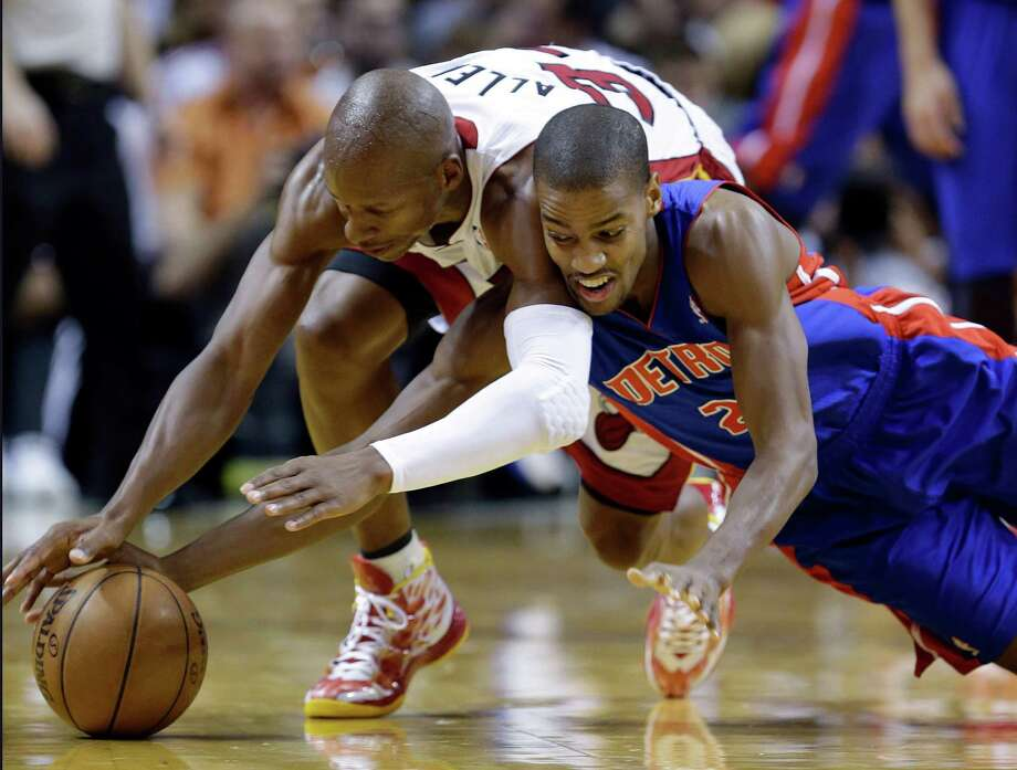 Detroit Pistons guard Kim English, right, and Miami Heat guard Ray Allen dive for a loose ball during the second half of an NBA basketball game, Friday, Jan. 25, 2013, in Miami. The Heat defeated the Pistons 110-88. (AP Photo/Wilfredo Lee) Photo: Wilfredo Lee, STF / AP