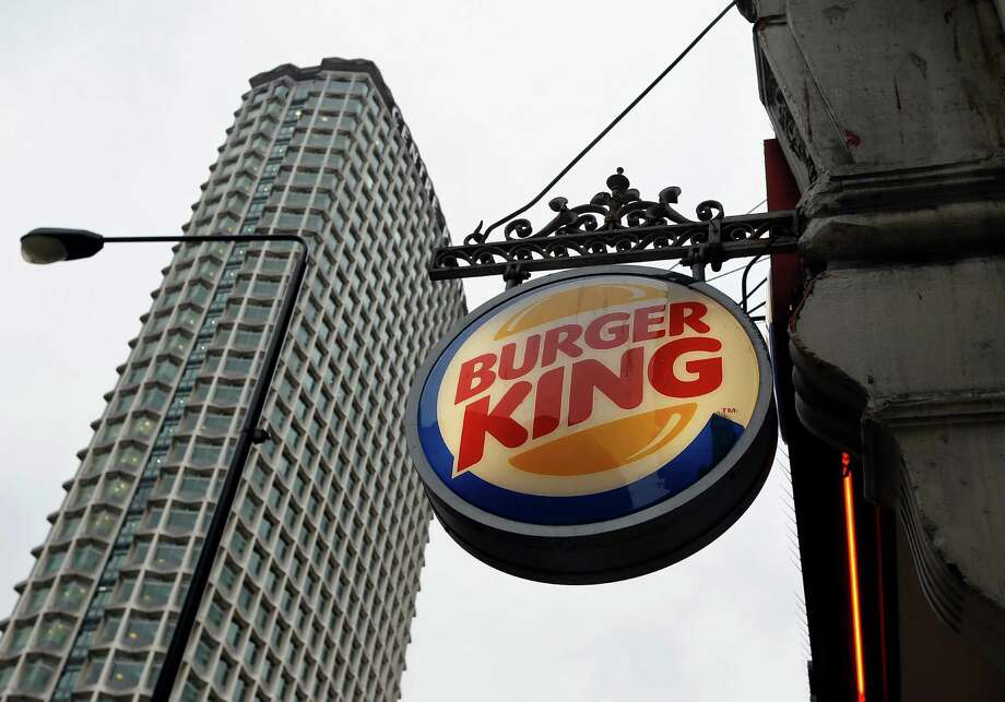 A sign hangs at a branch of Burger King in central London, Thursday, Jan. 24, 2013. Burger King says it has stopped buying beef from an Irish supplier whose patties in Britain and Ireland were found to contain traces of horsemeat. Officials say there is no risk to human health, but the episode has raised food security concerns. (AP Photo/Kirsty Wigglesworth) Photo: Kirsty Wigglesworth