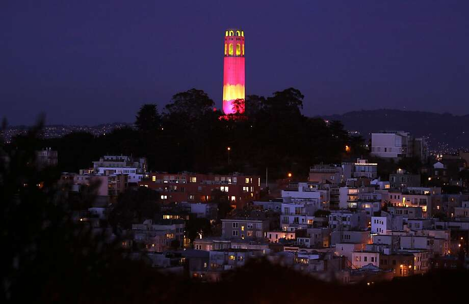 In honor of the San Francisco 49ers reaching the NFL playoff Coit Tower is light up in red. Built to fulfill the bequest of Lillie Hitchcock Coit, who left funds to be used to beautify the city she loved, Coit Tower is an icon on the San Francisco skyline, a simple tower crowning Telegraph Hill overlooking the San Francisco waterfront. Wednesday, Jan. 18, 2012. Photo: Lance Iversen, The Chronicle