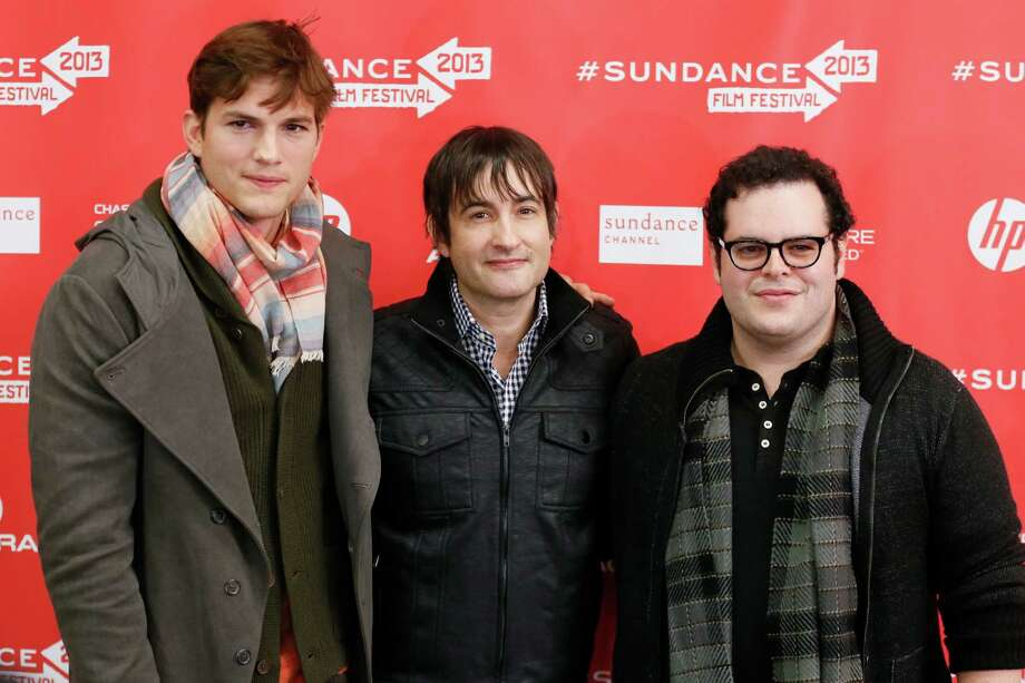 "From left, actor Ashton Kutcher, who portrays Steve Jobs, director Joshua Michael Stern, and actor Josh Gad, who portrays Steve Wozniak, pose together at the premiere of ""jOBS"" during the 2013 Sundance Film Festival on Friday, Jan. 25, 2013 in Park City, Utah. (Photo by Danny Moloshok/Invision/AP) Photo: Danny Moloshok"