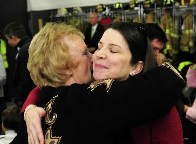 Newtown First Selectman Pat Llodra hugs Krista Rekos before the star and plaque dedication ceremony at the Sandy Hook Volunteer Fire & Rescue Company Saturday, Jan. 26, 2013. Rekos's daughter, Jessica, is one of the victims the stars represent. Photo: Michael Duffy / The News-Times