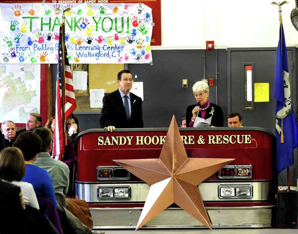 Gov. Dannel Malloy and Lt. Gov. Nancy Wyman read the names of the 26 Angels the stars represent during the star and plaque dedication ceremony at the Sandy Hook Volunteer Fire & Rescue Company Saturday, Jan. 26, 2013. Photo: Michael Duffy / The News-Times