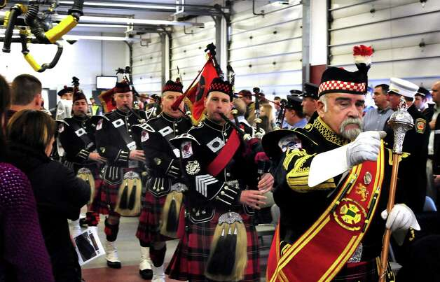 The Connecticut Firefighters Pipe & Drums open the star and plaque dedication ceremony at the Sandy Hook Volunteer Fire & Rescue Company Saturday, Jan. 26, 2013. Photo: Michael Duffy / The News-Times