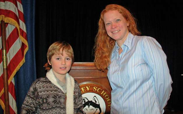 Hindley School's Geography Bee champion is Finn Kehrli, who is congratulated by his teacher, Jeanne Turschmann. Photo: Contributed