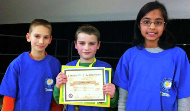 Fifth-grader Jackson Hart, center, won this year's Geography Bee at Ox Ridge School. The other top finishers were, left, Will Hamson, third place, and Riya Krishnan, second place. Hamson and Krishnan also are fifth-graders. Photo: Contributed