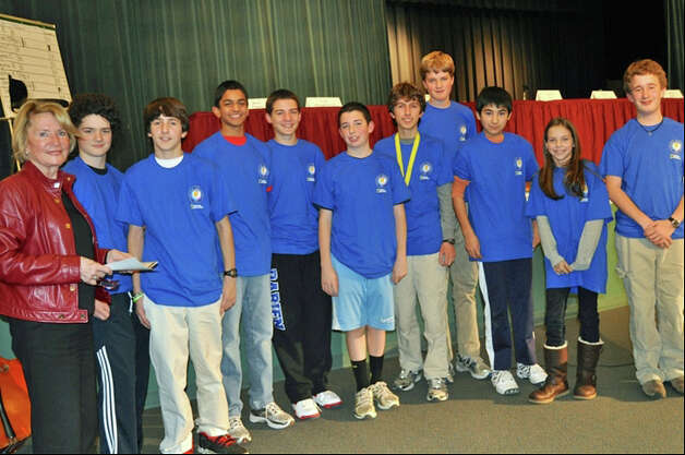 Middlesex Middle School's Geography Bee contestants, here with Barbara Ivey, Darien schoolsí bee coordinator, are, from left, Jimmy Conroy;  Mike Belloli; Aditya Krishnamacha, third place; Colin Shaughnessy; Nick Trager; Michael Borecki, winner; Tommy Paul, second place; John Selkowitz; Emma Hinton; and Thomas Cortellesi. Photo: Contributed
