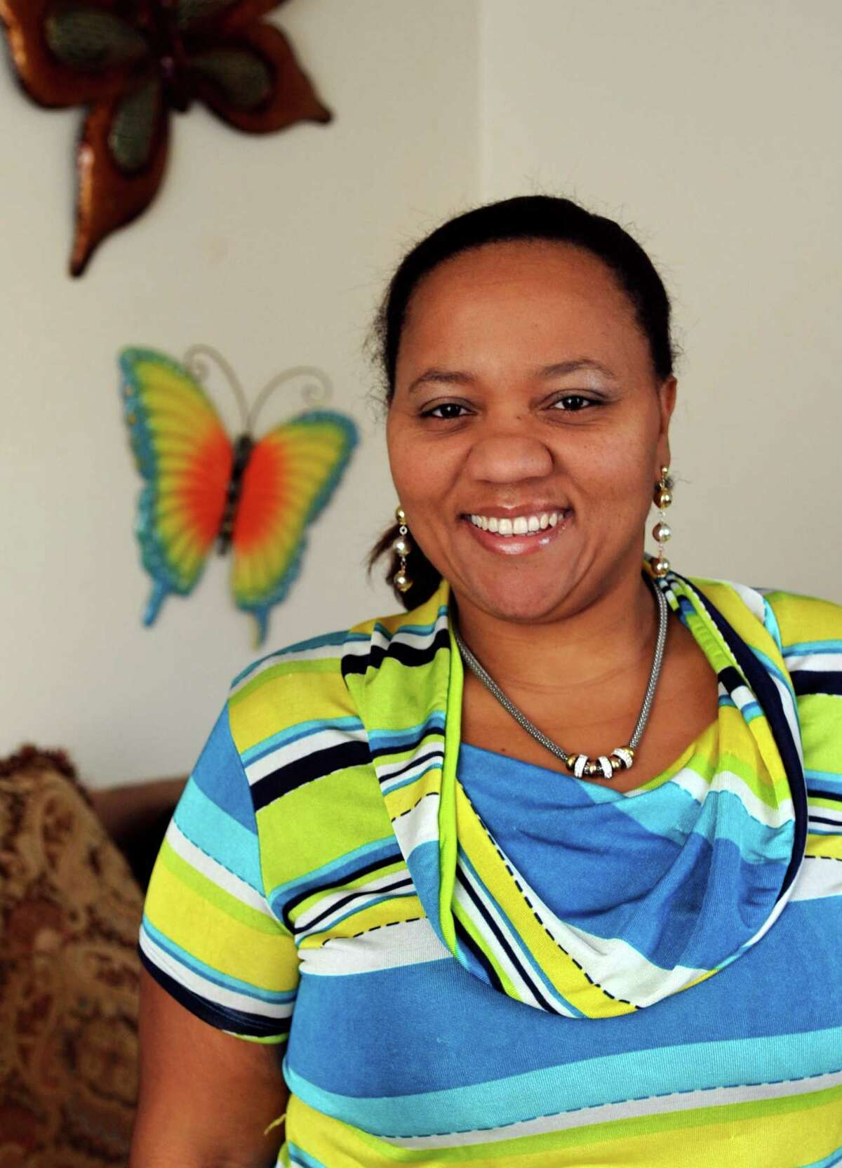 Evelyn Suarez poses for a photo in her Stamford home on Saturday, January 26, 2013.