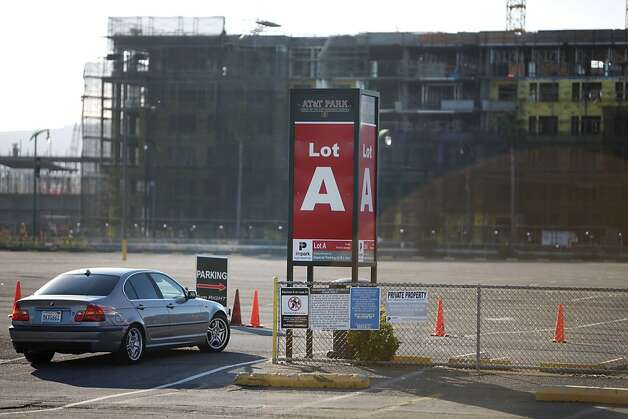 A car is seen entering the parking lot across the channel from AT&T park on Friday, January 25, 2013 in San Francisco, Calif. Photo: Lea Suzuki, The Chronicle