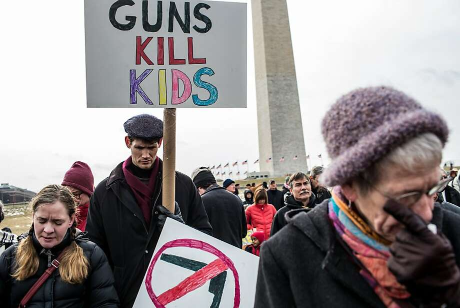 Thousands of people, including survivors of the shootings in Connecticut and at Virginia Tech, march on the National Mall in Washington in support of stricter federal controls on guns and ammunition. Photo: Brendan Hoffman, Getty Images