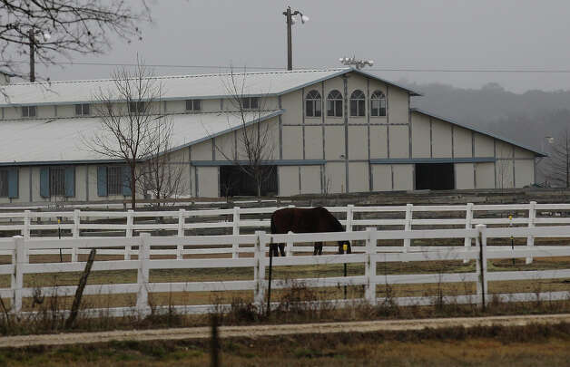 Exterior of the Wild Sunday Farm in North Bexar County. Wyatt McDaniel, 7, lost his life on Friday evening while he and his 5-year-old brother were playing in sand. Photo: Kin Man Hui, San Antonio Express-News / © 2012 San Antonio Express-News