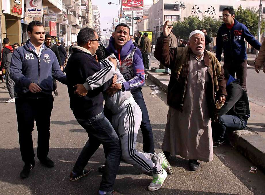 In Port Said, families and supporters of 21 soccer fans who were accused of murder in a 2012 stadium riot react to news of their death sentences. The announcement ignited bedlam. Photo: Mohammed Nouhan, Associated Press