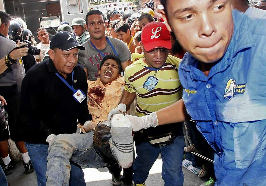 An injured inmate arrives at the hospital from  Venezuela's Uribana prison, where rioting erupted. Photo: Alexander Sanchez, Associated Press