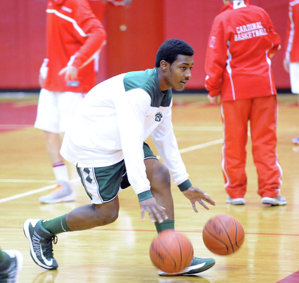 Jabari Dearof Norwalk warms-up prior to game against Greenwich at Greenwich, Tuesday night, Jan. 22, 2013. Dear's brother Roy Kane also plays on the team.