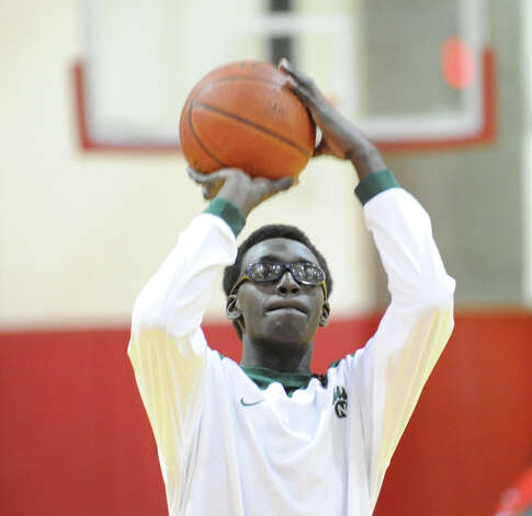 Roy Kane of Norwalk warms-up prior to game against Greenwich at Greenwich, Tuesday night, Jan. 22, 2013. Kane's brother Jabari Dear also plays on the team. Photo: Bob Luckey / Greenwich Time