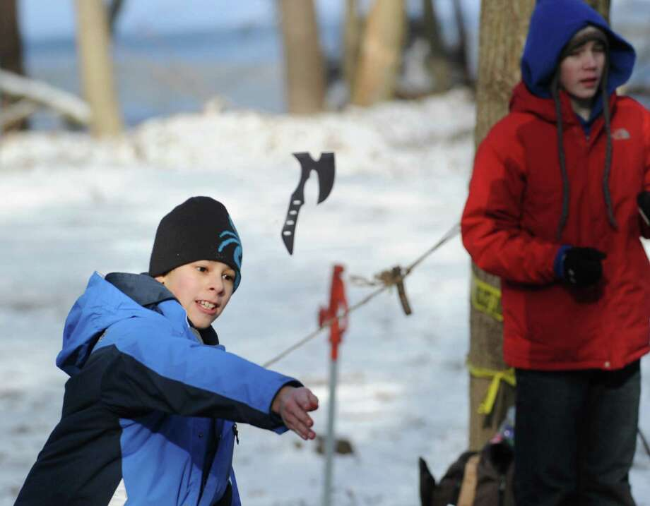 "Troop 11 Boy Scout, Kent Schneider, 11, throws a steel tomahawk during the Greenwich Boy Scouts annual Winter Klondike Derby, a winter camping and outdoor skills competition, at the Ernest Thompson Seton Scout Reservation in Greenwich, Saturday, Jan. 26, 2013. The theme for the derby was âÄúValley Forge: A Winter of Survival, A Winter of Victory!"", recalling General George Washington and his Revolutionary War soldiers, who survived the brutally cold winter of 1777 and later went on to defeat the British to win independence for the colonies. Photo: Bob Luckey / Greenwich Time"