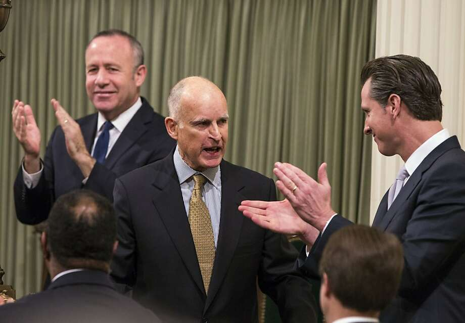 Gov. Brown's State of the State speech was triumphal yet tempered by caution. He is applauded by state Senate President Pro Tem Darrell Steinberg (left) and Lt. Gov. Gavin Newsom. Photo: Ken James, Bloomberg