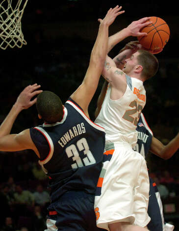 Syracuse's Eric Devendorf shoots between Connecticut's Gavin Edwards (24) and Hasheem Thabeet, rear, during second half basketball action at the Big East basketball tournament Wednesday, March 7, 2007, at Madison Square Garden in New York. Devendorf scored 19 points as Syracuse beat Connecticut 78-65. (AP Photo/Bill Kostroun) Photo: Bill Kostroun, ASSOCIATED PRESS / AP2007