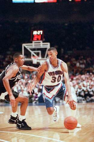 Kerry Kittles of Villanova (30) is guarded by Jason Murdock of Providence in the second half of a Big East Tournament game at Madison Square Garden, Saturday, March 11, 1995, New York. Kittles was game high scorer with 29 points to lead Villanova to a 90-75 win. Villanova faces Connecticut on Sunday in the finals. (AP Photo/Kathy Willens) Photo: Kathy Willens, ASSOCIATED PRESS / AP1995