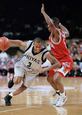 Georgetown?s Allen Iverson, left, drives to the lane against St. John?s Tarik Turner, right, in the first half in  Landover, Md., on Tuesday, Jan. 24, 1995. (AP Photo/Ted Mathias) Photo: ASSOCIATED PRESS