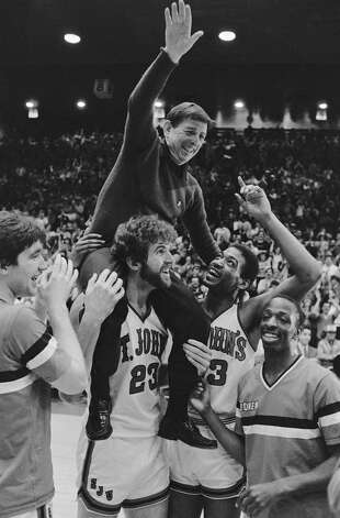 St Johns College players carry their coach , Lou Carnesecca after defeating Providence College 72-53 Saturday March 2, 1985 in New York. Players from left to right Chris Mullen; Bill Wennington; Ron Stewart; Mike Moses. (AP Photo) Photo: Anonymous, ASSOCIATED PRESS / AP1985