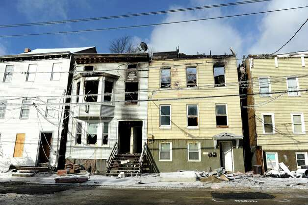 Fire-damaged houses on Dove Street on Saturday, Jan. 26, 2013, in Albany, N.Y. (Cindy Schultz / Times Union) Photo: Cindy Schultz