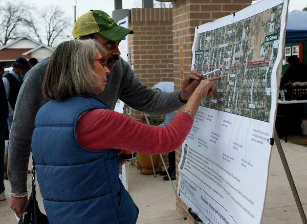 Yulanee McKnight and her son Chris, view a map of the Iowa Street Corridor revitalization project during a informational session about the project at the Davis-Scott Family YMCA on San Antonio's Eastside, Jan 26, 2013. Photo: Steve Faulisi, Express-News / ©2013 San Antonio Express-News