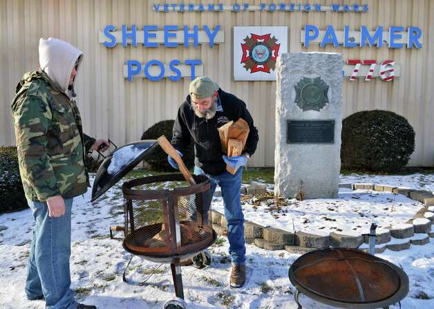 Sheehy Palmer VFW Post members Adam Vantine, left, and Tom Scul prepare fire pits for an all night sleep-out to create awareness for vets coming home who may end up homeless at the Albany VFW post Saturday Jan. 26, 2013.  (John Carl D'Annibale / Times Union) Photo: John Carl D'Annibale / 00020868A
