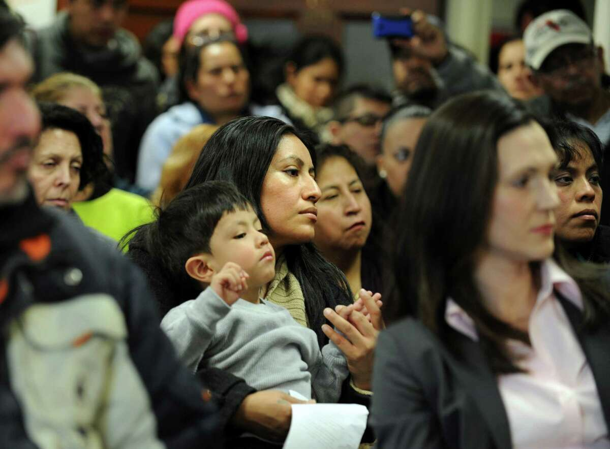 Micaela Zacatelco, of Fairfield, and her son Josue Rojas, 3, attend Connecticut Students for a DREAM's community roundtable Friday, Jan. 26, 2013 at the United Congregational Church of Bridgeport in Bridgeport, Conn.