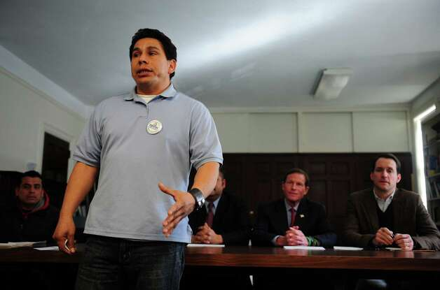Jose Alfredo Machado recites a poem he wrote during Connecticut Students for a DREAM's community roundtable calling for a path to citizenship for all undocumented immigrants and an end to family separations Friday, Jan. 26, 2013 at the United Congregational Church of Bridgeport in Bridgeport, Conn. Photo: Autumn Driscoll / Connecticut Post